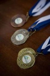 b_174_261_16777215_00_images_packages_medals.jpg